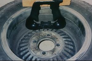 Early 280ZX caliper yoke against back of Western Cyclone wheel